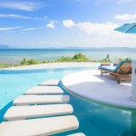 beach-chair-with-umbrella-on-private-pool-ocean-view