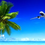 Airplane-Over-Tropical-Beach-shutterstock_189835466